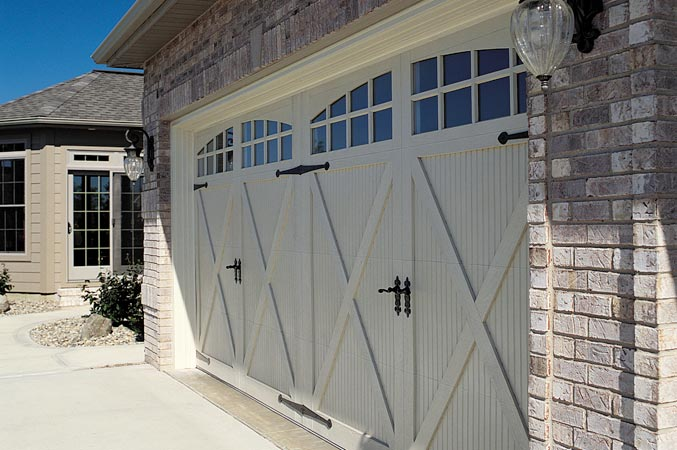 Carriage house steel garage doors windows and doors for Build carriage garage doors